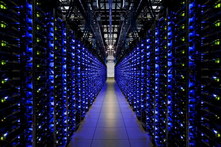 the-blue-leds-on-this-row-of-servers-let-employees-know-that-everything-is-running-smoothly-google-has-purchased-1000-megawatts-of-renewable-energy-to-power-these-data-centers-now-and-into-the-future