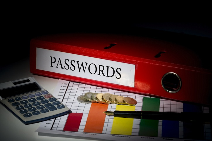 The word passwords on red business binder on a desk