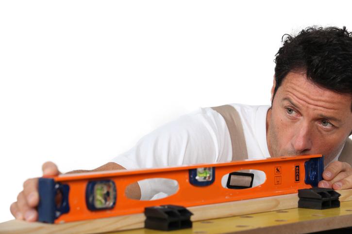 Mason measuring  wood