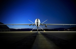An MQ-9 Reaper sits on the flightline.