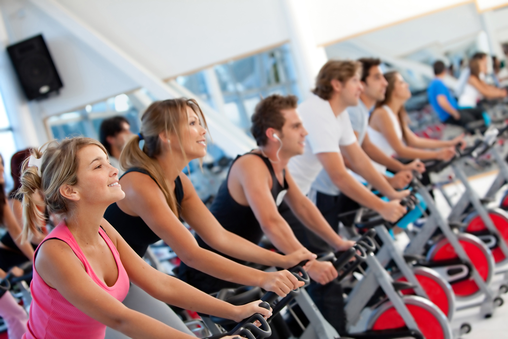 Gym people on spinning machines