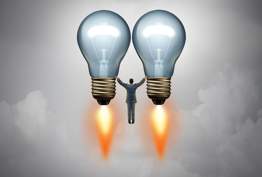 Entrepreneur success idea concept and investor symbol as a businessman or venture capitalist taking off on two lightbulbs as rockets with 3D illustration elements.